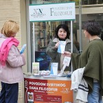 Croatia. World Philosophy Day. NA volunteers at an information stand in a square in Zagreb.